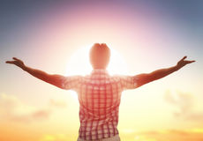 Man looking up to sunset sky. Successful man looking up to sunset sky celebrating enjoying freedom. Positive human emotion feeling life perception success, peace Stock Photography
