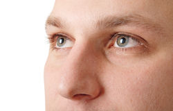 Man looking upwards. Young man eyes close-up portrait Royalty Free Stock Image
