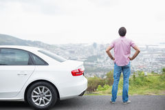 Man looking at the view near his car Royalty Free Stock Image