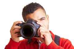 Man looking through a viewfinder Stock Image