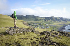 Man looking on Vik city, Iceland stock photos