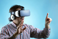 Man looking with virtual reality glasses and pointing with finge Stock Photo