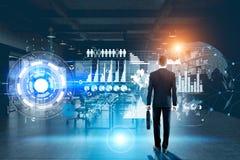 Man looking at virtual technology Stock Photo