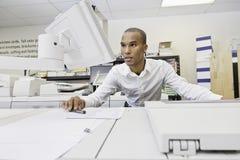 Man looking at visual screen Stock Photography