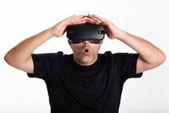 Man looking in VR glasses and gesturing with his hands. Stock Photography