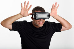 Man looking in VR glasses and gesturing with his hands. Stock Photo