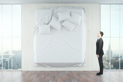 MAn looking at wall with bed Royalty Free Stock Photography