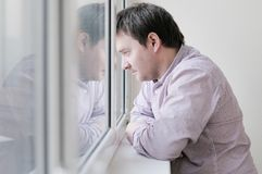 Man looking at the window Royalty Free Stock Photos