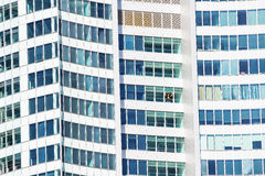Man looking through window of Q1 building, Gold Coast stock photo