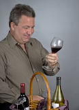 Man Looking at Wine Color royalty free stock images