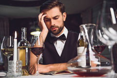 Man looking at wine with lost sight Stock Image