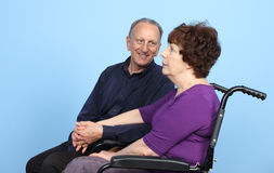 Man Looking At Woman On Wheelchair Royalty Free Stock Photo