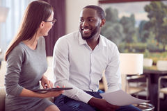 Man looking at woman while working Royalty Free Stock Photos