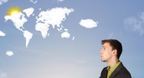 Man looking at world clouds and sun on blue sky Royalty Free Stock Photos