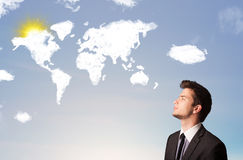 Man looking at world clouds and sun on blue sky Royalty Free Stock Photo