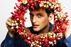 Man looking through a wreath Stock Photography