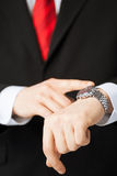 Man looking at wristwatch Royalty Free Stock Images