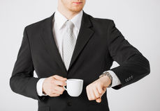 Man looking at wristwatch Royalty Free Stock Image