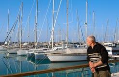 Man looking at yachts Stock Image