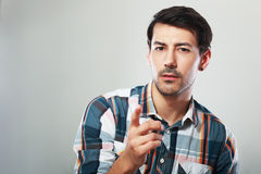 Man looking at you and point. Suspecious man looking at you and point his finger at you Royalty Free Stock Image