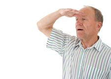 Man looks. Aged man looks in a distance. White background Royalty Free Stock Image
