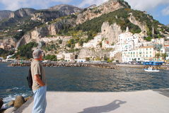 Man looks at Amalfi Italy. Mature man looks at the town of Amalfi, in Italy Royalty Free Stock Photos