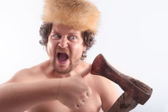 Man looks that the ax is sharp Royalty Free Stock Photo