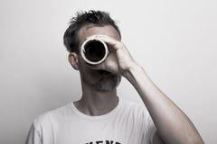 Man looks through a cardboard tube stock photos
