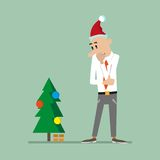 Man looks at the Christmas tree Royalty Free Stock Image