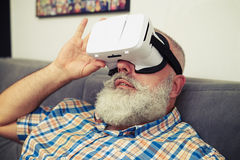 Man looks closely using modern VR headset glasses Royalty Free Stock Photos