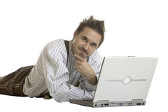 Man looks contemplative in front of his laptop Stock Image