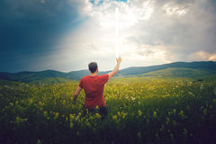 Man looks at cross in the sky. Man waiting for a miracle Stock Image