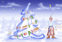 A man looks at the decorated firtree. A man, in the national Ukrainian suit, looks at the decorated firtree Stock Photo