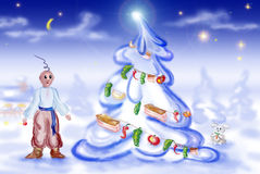A man looks at the decorated firtree. A man, in the national Ukrainian suit, looks at the decorated firtree Stock Photos