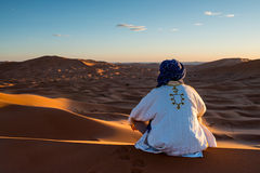 Man looks in the desert.  royalty free stock photo