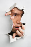 Man looks displeasure from cracked wall. One of the breakthrough series Royalty Free Stock Image