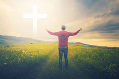 Man looks at ehite cross in the sky. Man waiting for a miracle Royalty Free Stock Images
