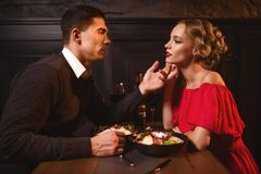 Man looks at the eyes of attractive woman in dress Royalty Free Stock Images