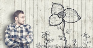 Man looks at a flower drawn Stock Photos
