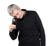Man looks at a glass of red port wine Royalty Free Stock Photos