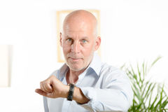 A man  looks at his watch Royalty Free Stock Image