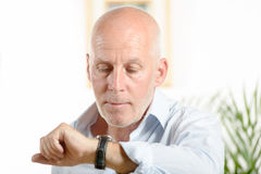 A man  looks at his watch Stock Photos