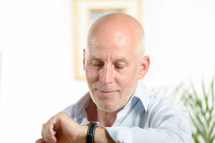 A man  looks at his watch Royalty Free Stock Photography