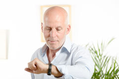 A man  looks at his watch Stock Photo