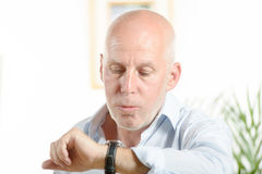 A man  looks at his watch Stock Images