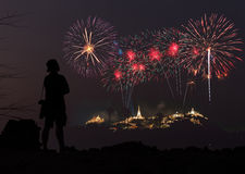 The man looks holiday fireworks in the evening sky Royalty Free Stock Photography