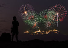 The man looks holiday fireworks in the evening sky Stock Photos