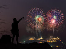 The man looks holiday fireworks in the evening sky Stock Photography