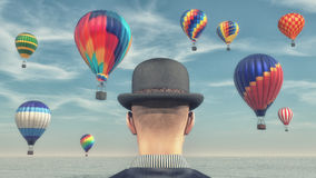 Man looks at hot air balloons. Man wearing a black hat and looking to hot air balloons flying through the sky. This is a 3d render illustration Royalty Free Stock Photo
