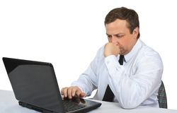 Man looks at the laptop monitor Stock Photo